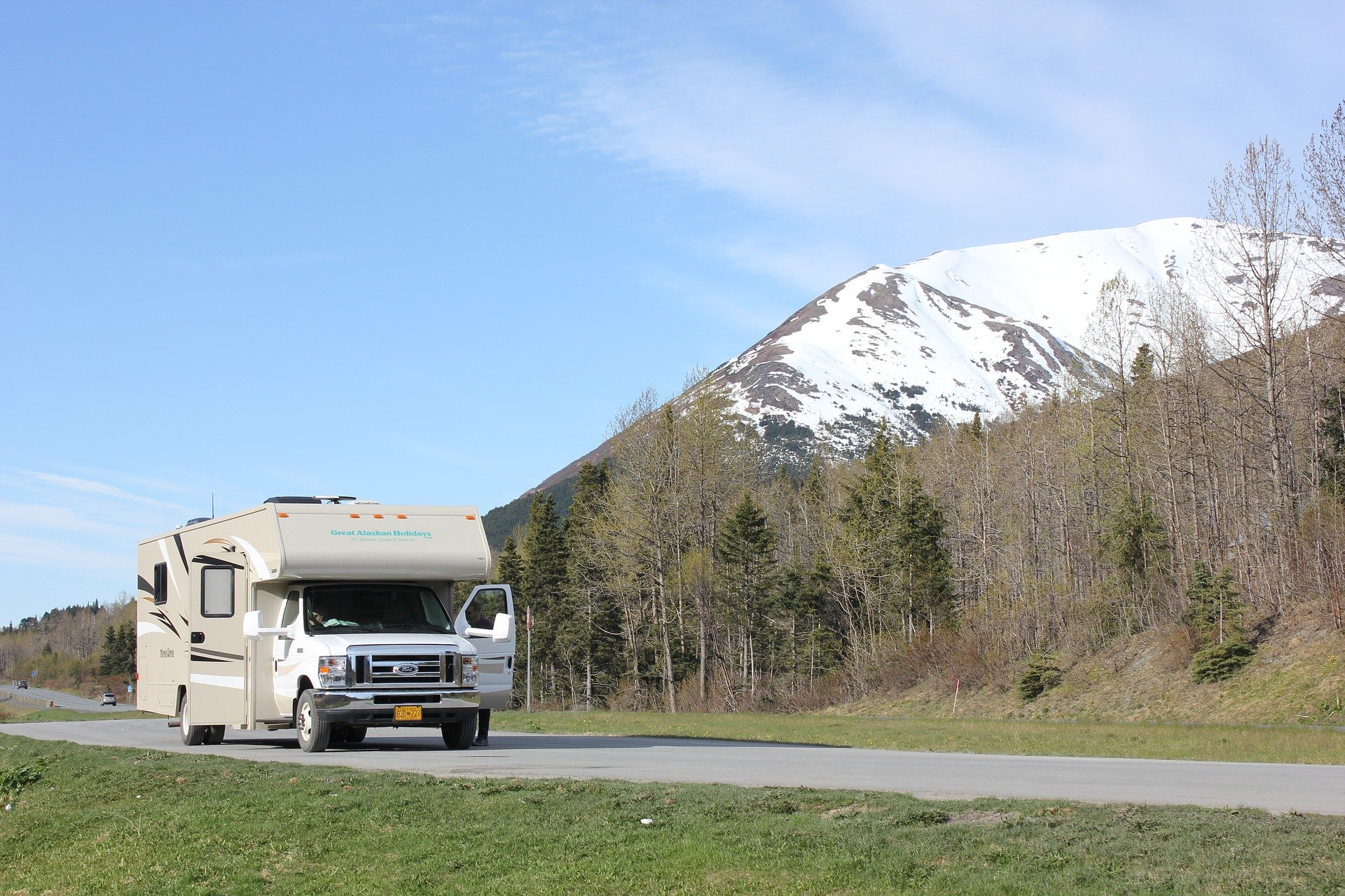 RV parked at the base of a snowy mountain, RV battery